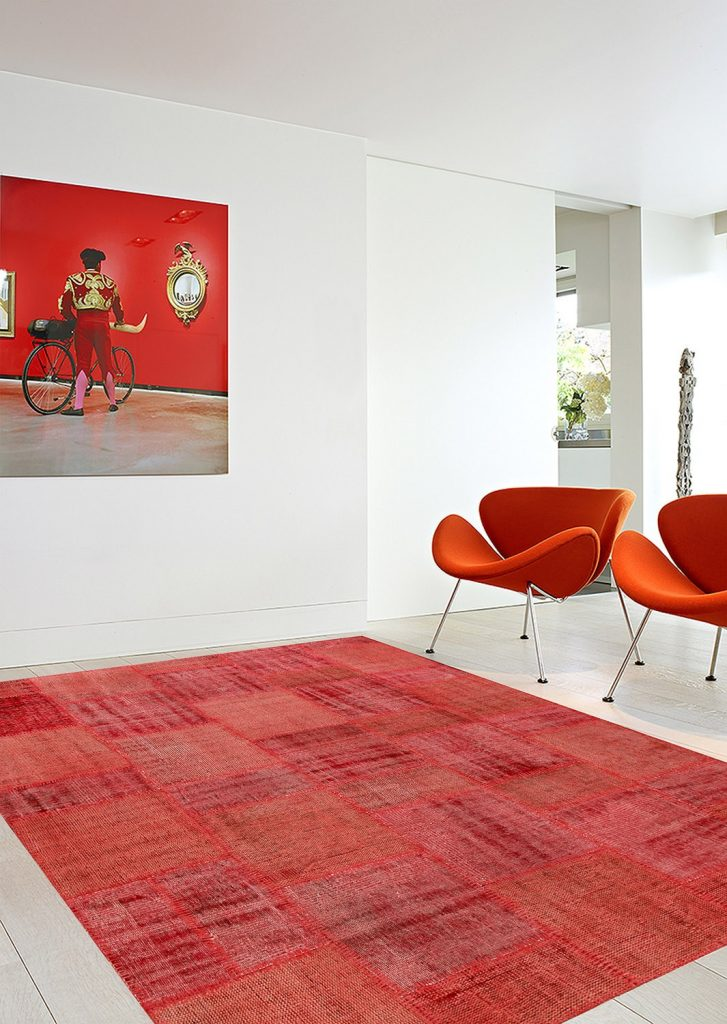 vintage patchwork overdyed red wool rug